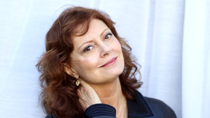 """In this Oct. 14, 2012 photo, actress Susan Sarandon, from the upcoming film """"Cloud Atlas,"""" poses for a portrait in Beverly Hills, Calif. The stars of """"Cloud Atlas,"""" along with British author David Mitchell, who wrote the novel that inspired the genre-bending epic about souls returning and intertwining over the centuries, shared their beliefs and disbeliefs about reincarnation as the film heads to U.S. theaters Oct. 26, 2012. Hanks himself doesn't buy into reincarnation, while Berry, Whishaw, Mitchell, Sarandon and co-stars Hugo Weaving and Jim Sturgess either believe or at least think it's possible that souls come back for an encore. (Photo by Matt Sayles/Invision/AP)"""