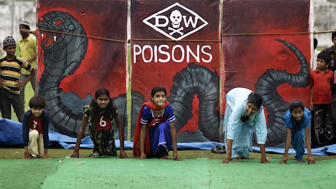 """Children suffering with birth defects compete in a 25 meters sprint event during a """"Special Olympics"""" held by the survivors of the deadly 1984 Bhopal gas leak in an effort to shame Olympic sponsor Dow Chemical Co. on the eve of the London Games in Bhopal, India, Thursday, July 26, 2012. Survivors say Dow owes them compensation for the world's worst industrial disaster and have campaigned to have the chemical giant dropped as a sponsor of the Olympics. Dow says it has no liability because it bought the company responsible for the plant more than a decade after the cases had been settled. (AP Photo/Altaf Qadri)"""