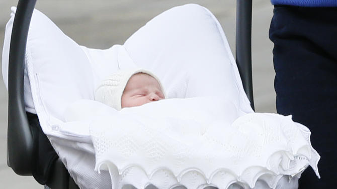 Britain's Prince William and Kate, Duchess of Cambridge, hold their newborn daughter as they as they pose for the media outside St. Mary's Hospital's exclusive Lindo Wing, London, Saturday, May 2, 2015. The Duchess gave birth to the Princess on Saturday morning. (AP Photo/Kirsty Wigglesworth)