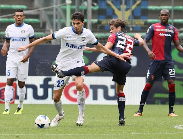 Inter Milan defender Andrea Ranocchia, left, and Cagliari's Matias Cabrera challenge for the ball during the Serie A soccer match between Cagliari and Inter, at the Nereo Rocco Stadium in Trieste, Ita