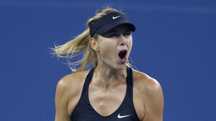 Maria Sharapova of Russia celebrates a point against Sabine Lisicki of Germany in their women's singles match at the 2014 U.S. Open tennis tournament in New York