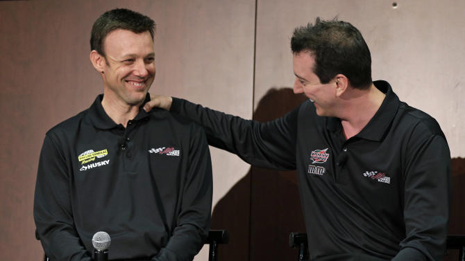 Kyle Busch, right, jokes with new teammate Matt Kenseth, left, during a news conference at Joe Gibbs Racing in Huntersville, N.C., Thursday, Jan. 24, 2013, as part of the NASCAR Sprint Cup Media Tour. (AP Photo/Chuck Burton)