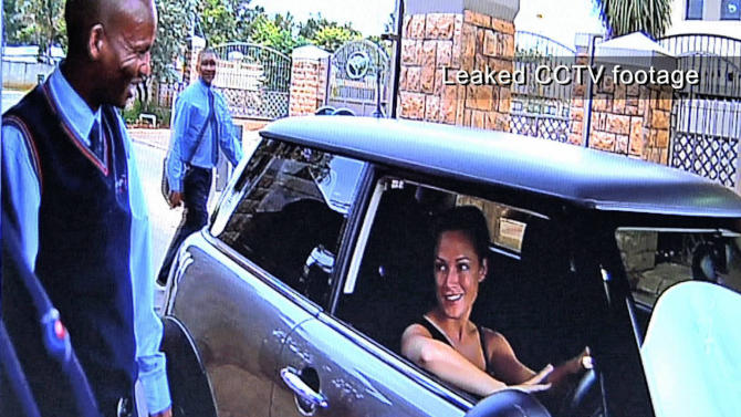 FILE - In this frame grab from CCTV footage leaked to M-Net's Carte Blanche program which viewed Sunday Feb 24, 2013, shows Reeva Steenkamp entering the secured access to the Silverwoods housing estate, home of Olympian athlete Oscar Pistorius,  some hours before she was shot and killed at Pistorius' home. Even if Pistorius is acquitted of murder, firearms and legal experts in South Africa believe that, by his own account, the star violated basic gun-handling regulations by shooting into a closed door without knowing who was behind it, exposing himself to the lesser but still serious charge of culpable homicide. (AP Photo/M-Net Carte Blanche, File)
