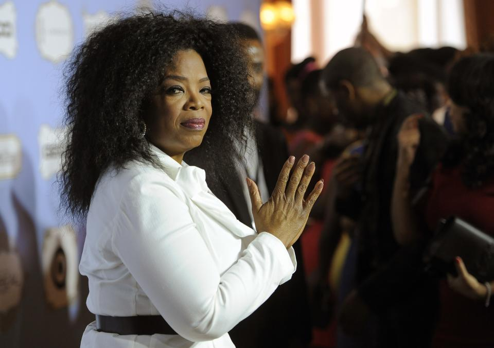 Oprah Winfrey, recipient of the Power Award, looks down the carpet at the 6th Annual Black Women in Hollywood Luncheon at the Beverly Hills Hotel on Thursday, Feb. 21, 2013 in Los Angeles. (Photo by Chris Pizzello/Invision/AP)