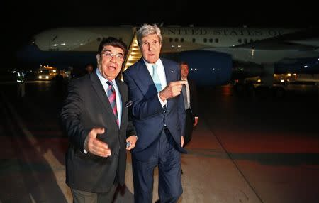 U.S. Secretary of State Kerry arrives in Afghanistan for diplomatic talks after his plane landed at Kabul International airport