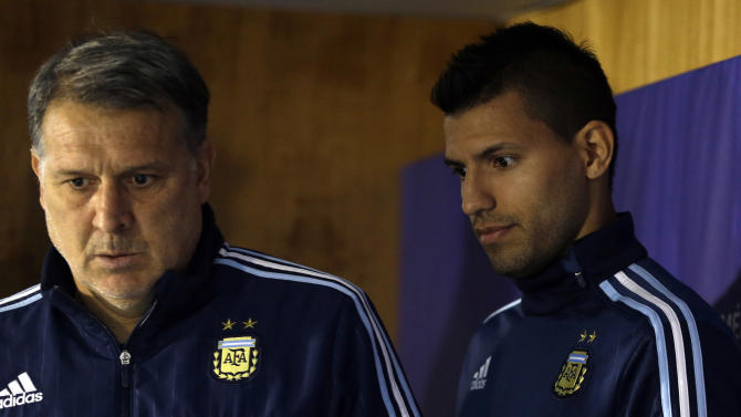 Argentina's coach Gerardo Martino, left, and Sergio Aguero, arrive for a press conference at the National Stadium in Santiago, Chile, Friday, July 3, 2015. Argentina will face Chile in the final of the Copa America soccer tournament Saturday. (AP Photo/Luis Hidalgo)