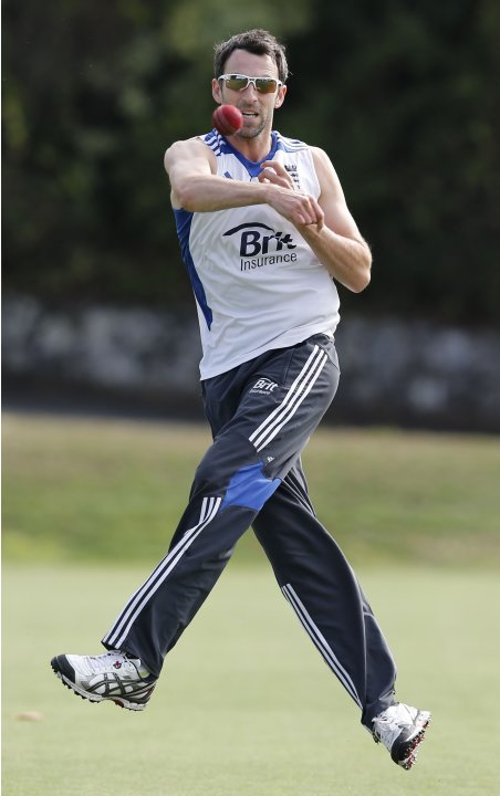 England's Graham Onions throws while at fielding practice ahead of the final cricket test against New Zealand in Auckland