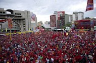Supporters of Venezuelan President Hugo Chavez attend a massive rally after he registered his candidacy in the National Electoral Center for the upcoming presidential election, in Caracas on June 11, 2012