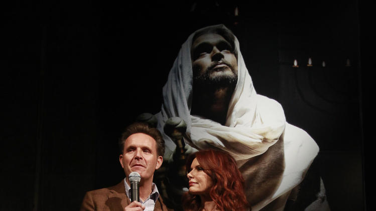 Producer Mark Burnett and producer and actress Roma Downey speaks to guest at the celebration of the April 2 Blu-ray, DVD, and Digital HD release of THE BIBLE from Twentieth Century Fox Home Entertainment  during The Bible Experience opening night gala, a rare exhibit of biblical artifacts on Tuesday, March 19 in New York. (Photo by Mark Von Holden/Invision for Fox Home Entertainment/AP Images)