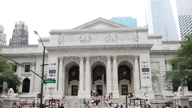 "This Friday, July 8, 2011 photo shows the New York Public Library during Celebrity Planet's ""Superhero Tour of New York"" in New York. Celebrity Planet's walking tour of midtown Manhattan takes guests to landmarks where events in comic book history took place.    (AP Photo/Tina Fineberg)"