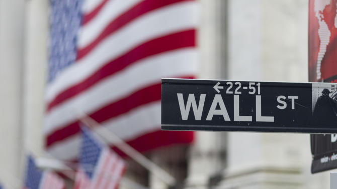 FILE - In this Aug. 8. 2011, file photo, a Wall Street sign hangs near the New York Stock Exchange. Stocks slipped in early trading Friday, May 22, 2015, as energy companies fell along with the price of oil. (AP Photo/Jin Lee, File)