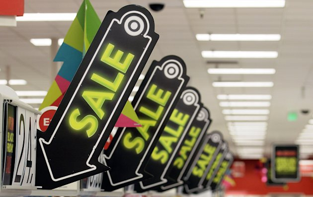 <p>               FILE -In this Friday, Nov. 23, 2012, file photo, sale signs are displayed at a Target store in Colma, Calif. Big retailers, from Best Buy to Target to Toys R Us, are engaging in a price war this holiday season, and shoppers can score some good deals if they know how to navigate them. But what's different this holiday season is that Best Buy and Target are matching online retailers such as Amazon.com for the first time. That's a big deal, since online prices tend to be lower than those in the store. (AP Photo/Jeff Chiu)