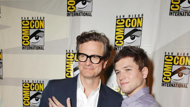 Colin Firth and Taron Egerton seen at Twentieth Century Fox Panel at 2014 Comic-Con on Friday, July 25, 2014, in San Diego, Calif. (Photo by Eric Charbonneau/Invision for Twentieth Century Fox/AP Images)