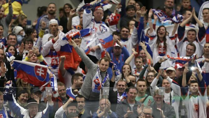 Slovakia's players celebrate their victory during the Hockey World Championships Group B match against Belarus in Ostrava, Czech Republic, Sunday, May 3, 2015. (AP Photo/Sergei Grits)