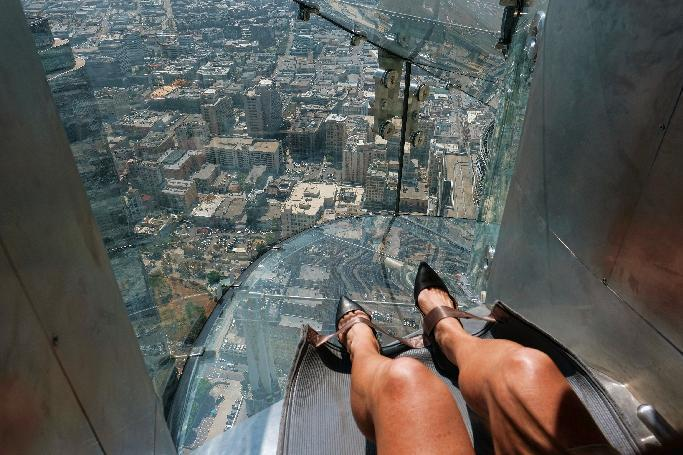 AP reporter's terrifying trip on 1,000-foot-high glass slide
