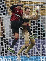 Nuremberg's goalkeeper Raphael Schaefer (R) and Frankfurt's defender Bamba Anderson fight for the ball during their German first division Bundesliga football match in Frankfurt, western Germany, on February 9, 2013. The match ended in a 0-0 draw