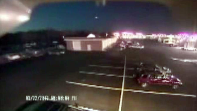 "In this image taken from video provided by Tom Hopkins of Hopkins Automotive Group, a bright flash of light, top center, streaks across the early-evening sky in what experts say was almost certainly a meteor coming down, Friday, March 22, 2013 in Seaford, Del. Bill Cooke of NASA's Meteoroid Environmental Office said the flash appears to be ""a single meteor event."" He said it ""looks to be a fireball that moved roughly toward the southeast, going on visual reports."" (AP Photo/Hopkins Automotive Group) MANDATORY CREDIT: HOPKINS AUTOMOTIVE GROUP"