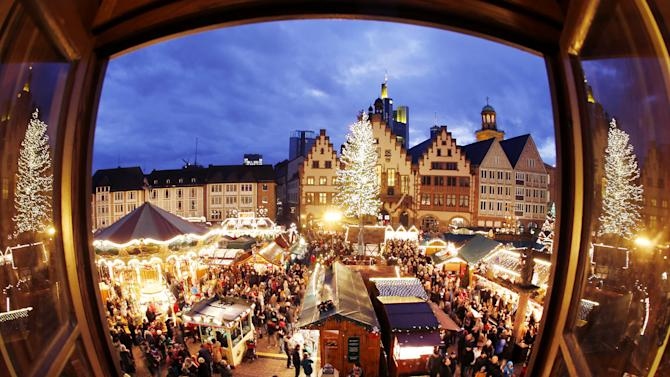 In this picture taken with a fisheye lens people gather on the traditional Christmas Market in Frankfurt, Germany, Saturday, Dec. 20, 2014. The market that runs until next Monday lures every year thousands of tourists. (AP Photo/Michael Probst)