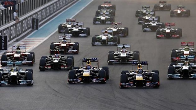 Red Bull Formula One driver Sebastian Vettel (front, 2nd R) of Germany leads the pack during the Abu Dhabi F1 Grand Prix at the Yas Marina Circuit in Abu Dhabi November 3, 2013 (Reuters)