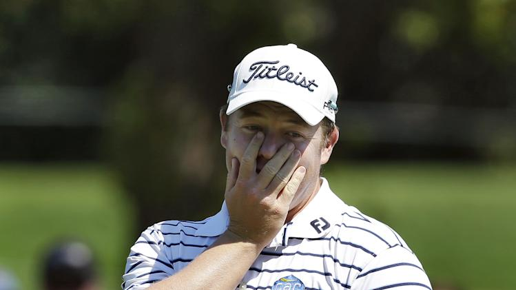 George Coetzee reacts after missing a birdie putt on the fifth hole during the third round of the Tampa Bay Championship golf tournament Saturday, March 16, 2013, in Palm Harbor, Fla. (AP Photo/Chris O'Meara)