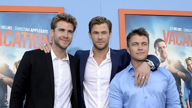 "Cast member Chris Hemsworth (C) poses with his brothers actors Liam Hemsworth (L) and Luke Hemsworth during the premiere of the film ""Vacation"" at the Regency Village Theatre in the Westwood section of Los Angeles"