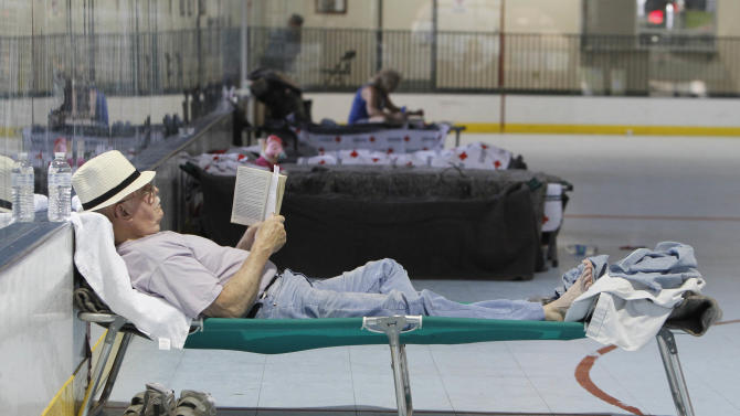 Dale Kempf relaxes with a book at a Red Cross evacuation center in Redding, Calif., Monday, Aug. 20, 2012. Kemp was  forced to flee his home in Manton, Saturday due to the Ponderosa Fire. Residents of the small towns, of Manton, Viola and Shingletown were forced to evacuate as flames from the fire neared.  The fire, that started Saturday, has  destroyed seven homes, burned 23 square miles and is only 5 percent contained. (AP Photo/Rich Pedroncelli)