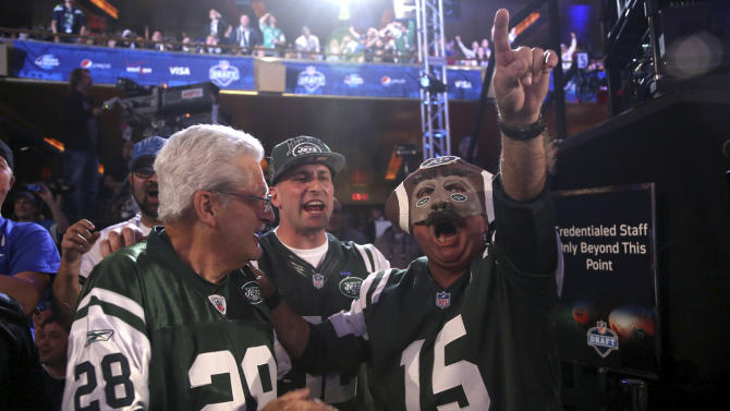 New York Jets fans watch as their team makes a selection during the second round of the NFL football draft on Friday, April 26, 2013, at Radio City Music Hall in New York. (AP Photo/Mary Altaffer)