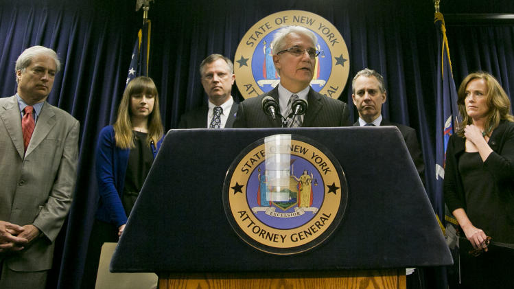 "Citizens Crime Commission of New York president Richard Aborn, far left, Annie Palazzolo, second from left, and her father Paul Boke, third from left, New York Attorney General Eric Schneiderman, second from right and Nassau County, N.Y. Distrct Attorney Kathleen Rice, far right, listens as San Francisco District Attorney George Gascon speaks during a press conference on Thursday, June 13, 2013, in New York. The group announced the launch of what they call the ""Secure Our Smartphones Initiative"" aimed at encouraging the cell phone industry to adapt technology to deter cellphone theft. Palazzolo, 29, spoke about her sister who was killed for her cellphone. (AP Photo/Bebeto Matthews)"