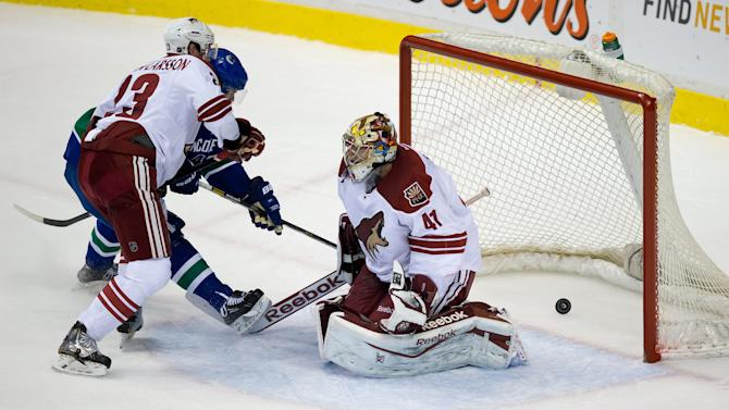 Bieksa's OT goal lifts Canucks past Coyotes