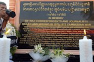 A Cambodian photographer takes a picture next to a memorial in Phnom Penh, on February 6, 2013. Cambodia has unveiled a memorial to dozens of foreign and local journalists who died while covering the 1970-75 war that was won by the communist Khmer Rouge regime