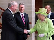 Britain&#39;s Queen Elizabeth II shakes hands with Northern Ireland Deputy First Minister Martin McGuinness at the Lyric Theatre in Belfast, in a landmark moment in the Northern Ireland peace process, Buckingham Palace said