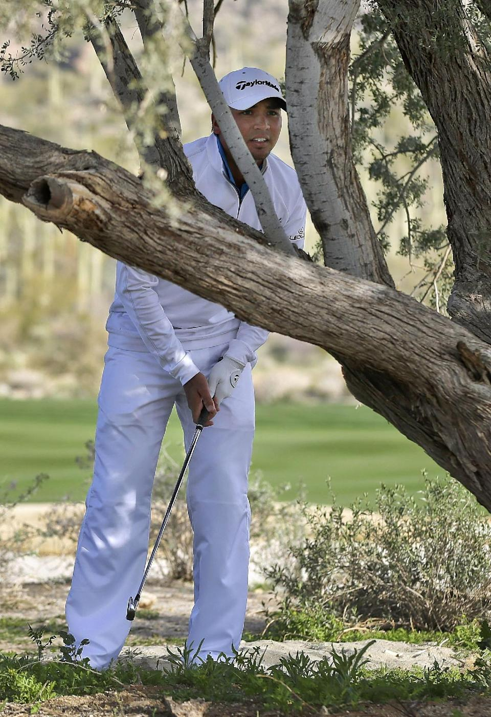 Jason Day checks his line to the pin on the seventh hole before hitting from behind a tree in the semifinal round of play against Matt Kuchar during the Match Play Championship golf tournament, Sunday, Feb. 24, 2013, in Marana, Ariz. (AP Photo/Julie Jacobson)