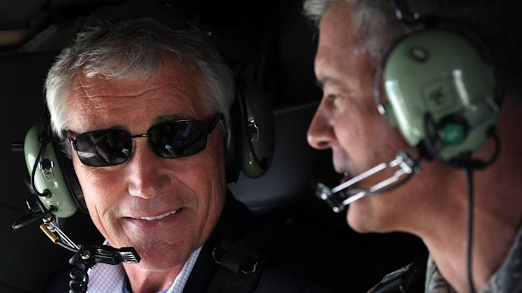 "U.S. Secretary of Defense Chuck Hagel, left, talks to Commander of U.S. Force Japan Lt. Gen. Salvatore ""Sam"" Angelella during a helicopter ride Saturday, April 5, 2014 from Yokota Air Force Base in Fussa, to Tokyo in Japan. Hagel is on an Asian trip, the fourth since he took office, to Japan, China and Mongolia. (AP Photo/Alex Pool, Pool)"