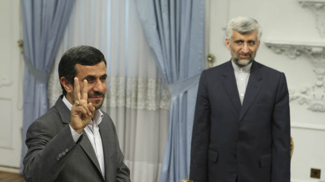 FILE - In this Tuesday, Aug. 16, 2011 file photo, Iranian President Mahmoud Ahmadinejad, left, flashes a victory sign, as Iran's top nuclear negotiator Saeed Jalili, looks on, prior to their meeting with Russia's Security Council Secretary, Nikolai Patrushev, at the presidency office, in Tehran, Iran. Iran has made no secret of its hopes for the next round of nuclear negotiations with world powers: Possible pledges by the West to ease sanctions as a step toward deal making by Tehran. (AP Photo/Vahid Salemi, File)