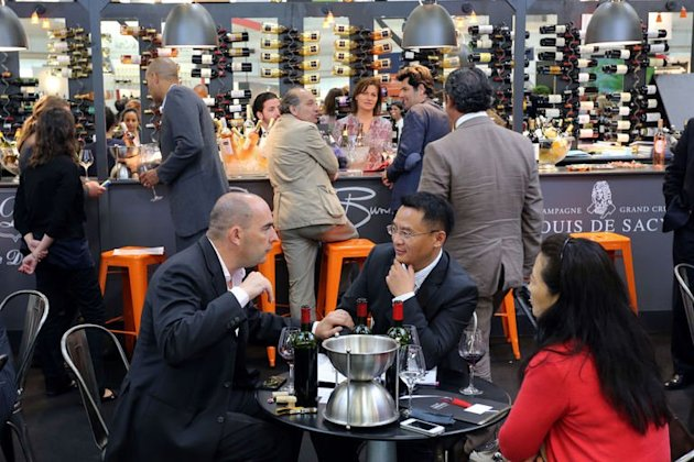 People taste wines during the Vinexpo trade fair in Bordeaux, southwestern France, on June 17, 2013