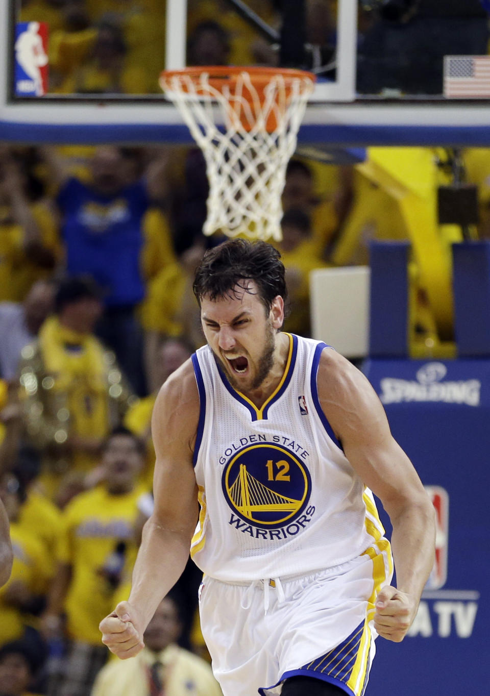 Golden State Warriors' Andrew Bogut reacts after scoring against the Denver Nuggets during the first half of Game 4 in a first-round NBA basketball playoff series, Sunday, April 28, 2013, in Oakland, Calif. (AP Photo/Ben Margot)