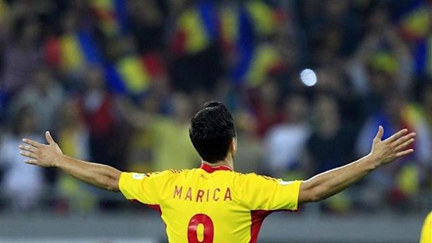 Ciprian Marica scored twice to help Romania secure a World Cup playoff spot