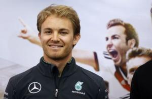 Mercedes Formula One driver Rosberg of Germany poses after a German soccer team news conference in St. Martin