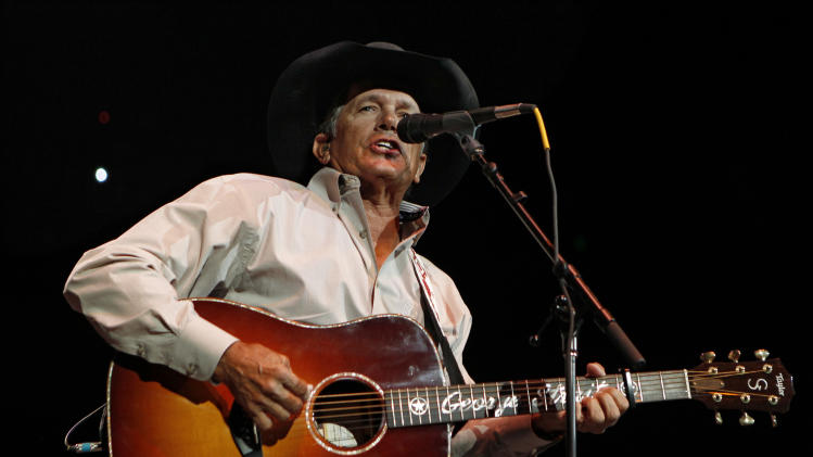 FILE - In this Oct. 17, 2011 file photo, George Strait performs during the Fire Relief, The Concert For Central Texas, at the Frank Erwin Center in Austin, Texas. The 60-year-old country music superstar on Wednesday, Sept. 26, 2012 announced that he'll embark on his final concert tour early next year. He made the announcement at a news conference at the Country Music Hall of Fame & Museum in Nashville, Tenn.   (AP Photo/Erich Schlegel, File)