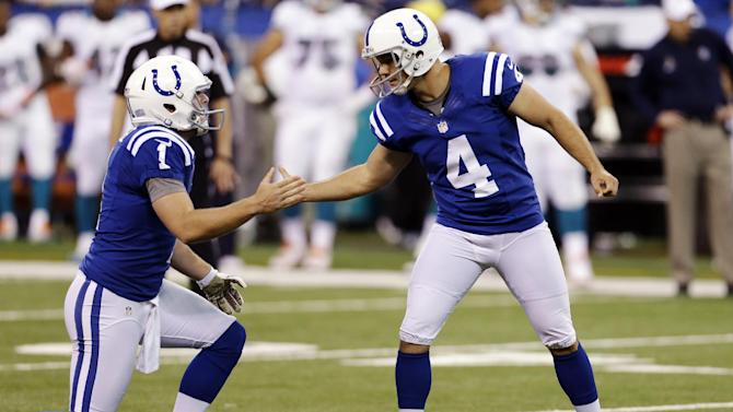 Indianapolis Colts kicker Adam Vinatieri (4) celebrates with holder Pat McAfee after making a field goal during the second half of an NFL football game against the Miami Dolphins in Indianapolis, Sunday, Nov. 4, 2012. (AP Photo/Darron Cummings)