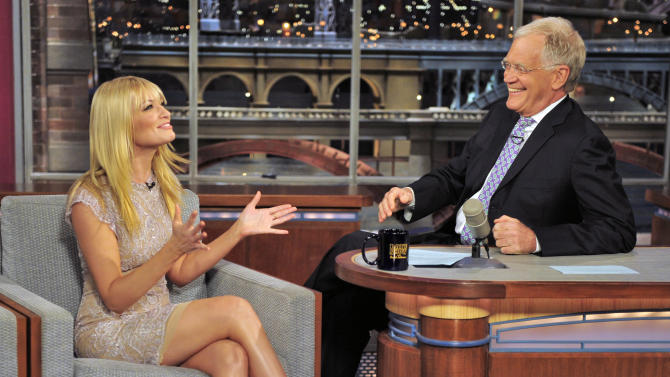 "FILE - In this May 7, 2012 file photo provided by CBS, Beth Behrs, co-star of ""Two Broke Girls"" talks with host David Letterman on the set of the ""Late Show with David Letterman,"" in New York. Hurricane Sandy didn't just halt airline flights and the stock market on Monday, Oct. 29, 2012, it also caused widespread cancellations across the entertainment industry. David Letterman and Jimmy Fallon are doing their shows without an audience because of the storm. (AP Photo/CBS, John Paul File) MANDATORY CREDIT; NO ARCHIVE; NO SALES; NORTH AMERICAN USE ONLY"