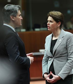 Croatia's Prime Minister Zoran Milanovic, left, talks with Slovenia's Prime Minister Alenka Bratusek, at an EU summit in Brussels on Wednesday, May 22, 2013. Leaders from the 27 European Union countries gather in Brussels for one of their regular European Council sessions. On the agenda is the increasingly controversial subject of tax evasion. (AP Photo/Yves Logghe)