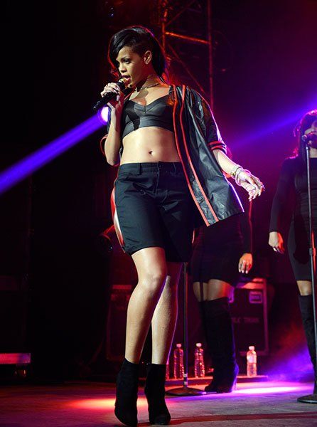 Day 1: Rihanna on stage in Mexico City - Mel Ottenberg, Rihanna's tour stylist, told Vogue.com that this &quot;Hood Glamour&quot; look consisted of &quot;boys' thug clothes mixed with diamonds and pulled-together ha