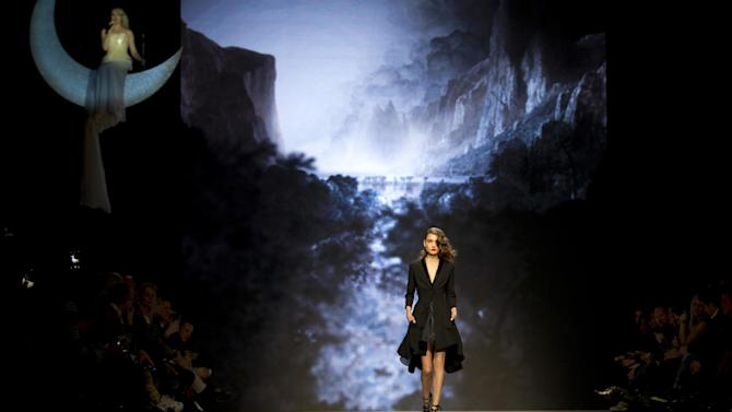 A model wears a creation for designer Dennis Diem's 2015 collection, during the Fashion Week in Amsterdam, Netherlands, Sunday, Jan. 25, 2015. (AP Photo/Peter Dejong)