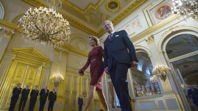 Belgium's King Philippe and Queen Mathilde arrive in the throne room before delivering a speech during a traditional new year reception at the Brussels Royal Palace