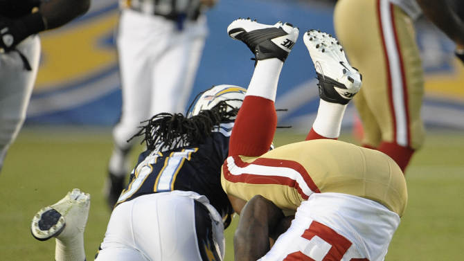 San Francisco 49ers running back Kendall Hunter is turned up side down by San Diego Chargers defensive back Bob Sanders after a 5-yard gain during the first quarter of an NFL preseason football game Thursday, Sept. 1, 2011, in San Diego. (AP Photo/Denis Poroy)