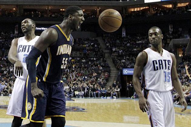 Indiana Pacers' Roy Hibbert (55) reacts after making a basket as Charlotte Bobcats' Kemba Walker (15) stands by during the second half of an NBA basketball game in Charlotte, N.C., Wednesday, Nov. 27,