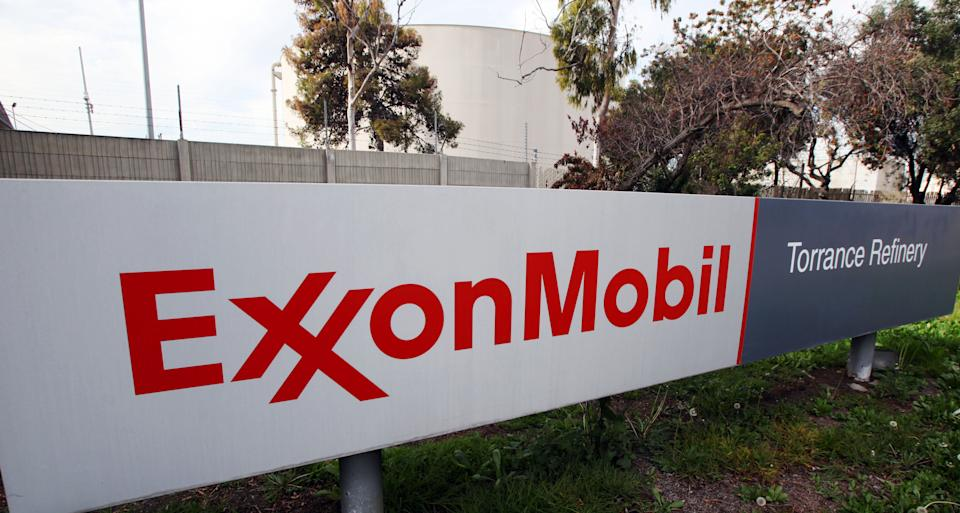 This Jan. 30, 2012 photo, shows the sign for the ExxonMobil Torerance Refinery in Torrance, Calif. Exxon Mobile reports quarterly financial results before the market opens on Thursday, April 25, 2013. (AP Photo/Reed Saxon)