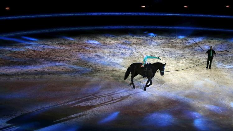 Rider and artist perform during the opening ceremony of the world Equestrian Games at the d'Ornano stadium in Caen