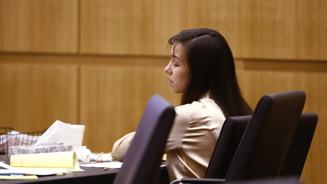 Jodi Arias reacts as the jury begins deliberation whether there was an aggravating factor in the murder of Travis Alexander on Wednesday, May 15, 2013, during the sentencing phase of her trial at Maricopa County Superior Court in Phoenix. If the jury finds aggravating factors in her crime, Arias could be sentenced to death.   (AP Photo/The Arizona Republic, Rob Schumacher, Pool)